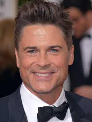Rob Lowe arrives at the 71st annual Golden Globe Awards at the Beverly Hilton Hotel on Sunday, Jan. 12, 2014, in Beverly Hills, Calif.