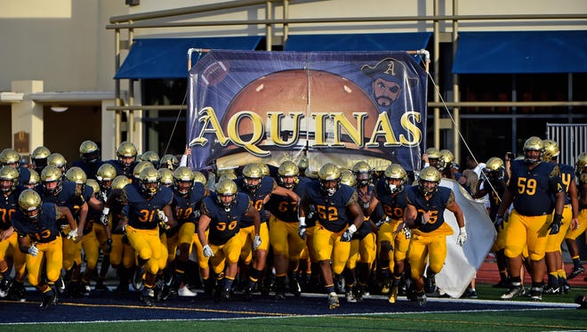 The St. Thomas Aquinas Raiders take to the field prior to the game against the St. John Bosco Braves on Agu. 25, 2017.