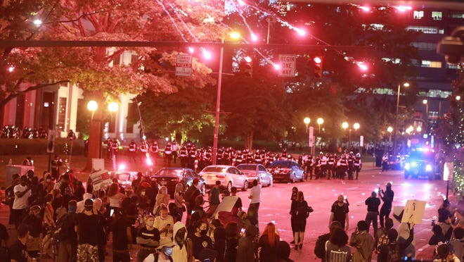 Police set off a crowd-dispersal firework on N. Front St. in front of City Hall as several hundred people protested the death of Minneapolis resident George Floyd in downtown Columbus on Friday, May 29, 2020.