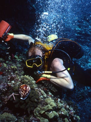"""Master diver, marine cartographer and underwater photographer David """"Doc"""" Cunningham worked with Jacques Cousteau and Greenpeace. He will give a free talk and show his slides at Lakes Regional Library on Friday."""