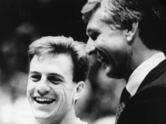 Former CBA standout John Crotty (left) stands with Virginia coach Terry Holland prior to a game in 1990, while Crotty was the Cavaliers' point guard.