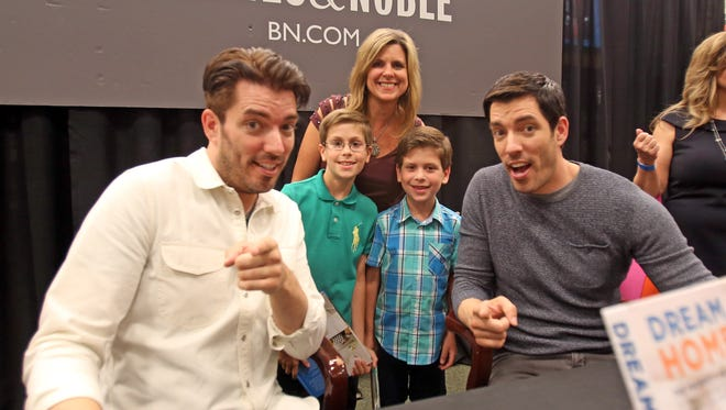 Christine Powell and her sons, Nicholas, 11, and Christopher, 8, take a photo with Property Brother's Jonathan and Drew Scott during a book signing at Barnes & Nobles in White Plains on June 27, 2016.