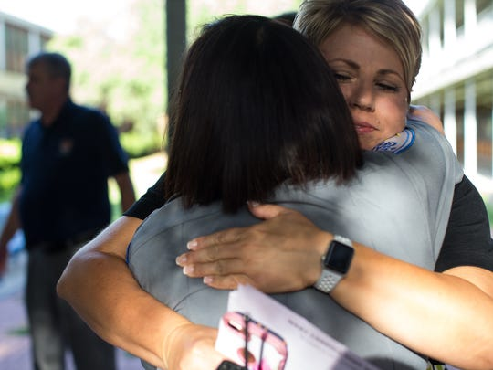 A security guard at Carroll High school hugs Principal Kelly Manlove on the first day of school Tuesday, Sept. 5, 2017. Kelly Manlove, a Rockport resident, lost her home and belongings when Hurricane Harvey made landfall Aug. 25, 2017.