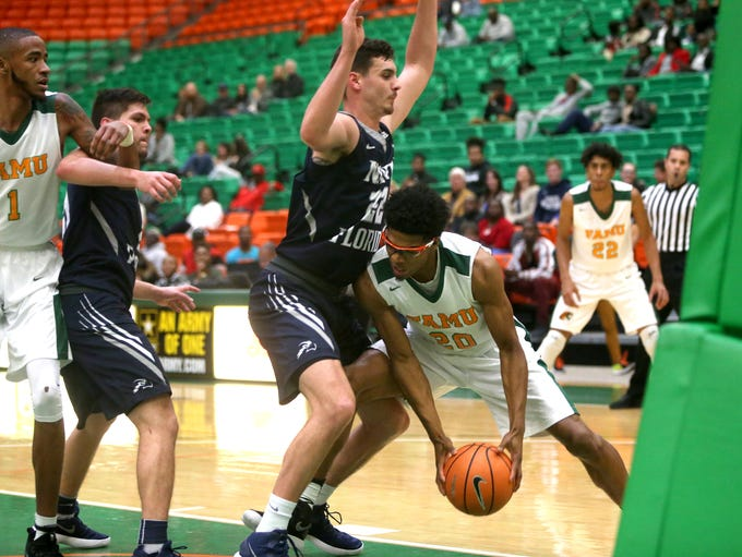 FAMU's Brendon Myles drives to the basket during the
