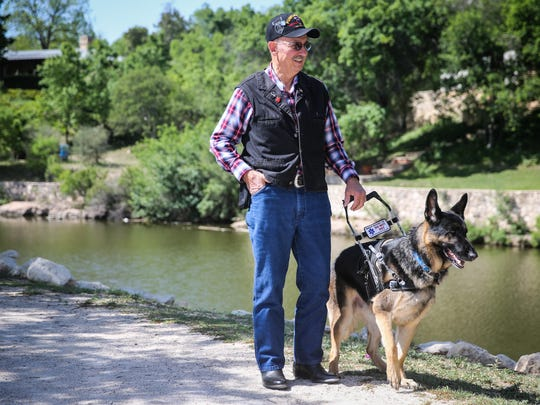 Phillip Dowsett walks with Rex, his German Shepherd