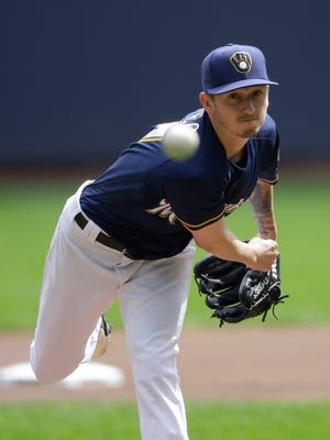 Brewers starting pitcher Zach Davies throws during the first inning against the Cubs.