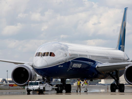 FILE - In this Friday, March 31, 2017, file photo, Boeing employees walk the new Boeing 787-10 Dreamliner down towards the delivery ramp area at the company's facility in South Carolina after conducting its first test flight at Charleston International Airport in North Charleston, S.C. The Boeing Co. reports earnings, Wednesday, April 26, 2017. (AP Photo/Mic Smith)
