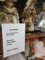 A memorial to Sylvester 'Button' Combs Jr. in the window