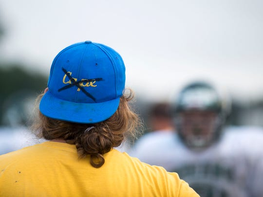 Indian River coach sports a modified Cape Henlopen hat as the team practices in Dagsboro.