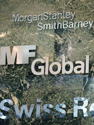An MF Global corporate sign is shown at a New York City office building in Nov. 2011, shortly after the brokerage collapsed in bankruptcy.