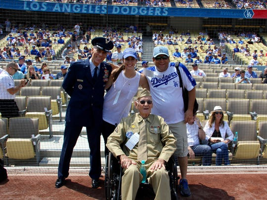From left, U.S. Air Force Col. Ron Prosise of Bermuda Dunes was honored as Military Hero of the Game at Dodger Stadium during the team's game against the Chicago Cubs on Saturday, Aug. 27, 2016. Standing next to Prosise is daughter Anna Prosise and Jeff Lee, Associate Pastor, Family Heritage Church in La Quinta. Seated is World War II veteran Leonard Cole, a member of Family Heritage Church.
