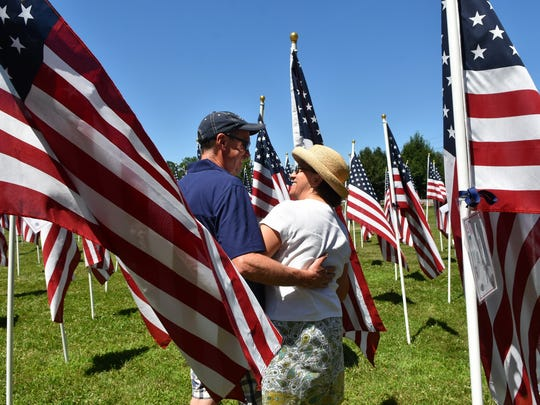 Tim and Dominae Laveille of Bedminster share a moment in the Field of Honor.