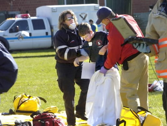 Volunteers work during a terrorism drill in Fairview Township several years ago. Do you know what you would do in an emergency? DAILY RECORD/SUNDAY NEWS -- FILE