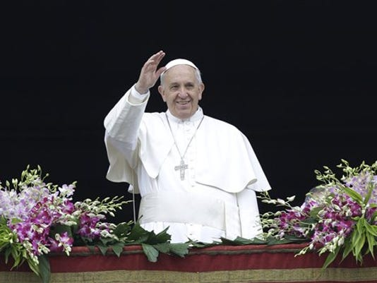Pope Francis delivers a blessing at the end of the Easter Sunday Mass in St. Peter's Square at the Vatican this year.