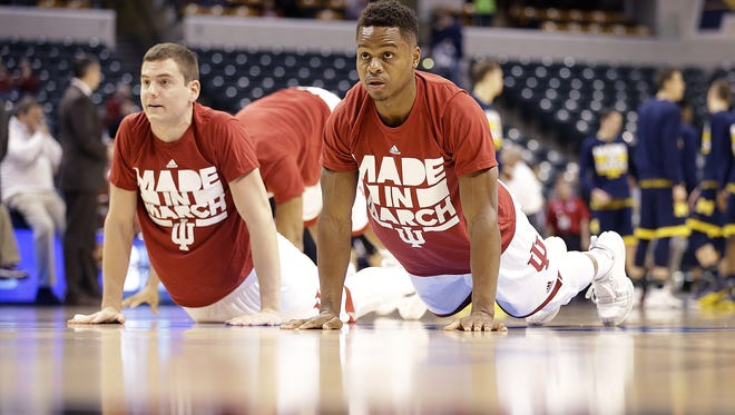 Indiana Hoosiers Yogi Ferrell (11),right, and Nick Zeisloft (2),left, stretch out before of their Big Ten Men's Basketball Tournament game against the Michigan Wolverines Friday, Mar 11, 2016, afternoon at Bankers Life Fieldhouse.