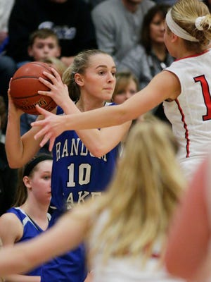 Random Lake's Alicia Hartmann (10) looks to pass the ball against Oostburg during a February game.