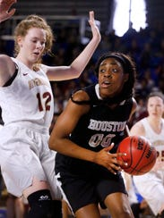 Houston's Jayla Hemingway (00) goes up for a shot as