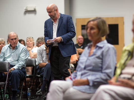 Brett Blackledge, then the investigations editor at the Naples Daily News in Florida, collects audience questions during a Collier County School Board election forum in the Daily News studio in 2016. Blackledge was named the editor of Lafayette Daily Advertiser on March 18, 2019.
