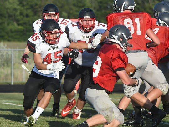 Crestview middle linebacker Colton Campbell pursues