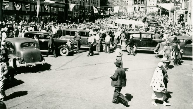 Protesters used automobiles to block streets during the Lansing Labor Holiday, June 7, 1937.
