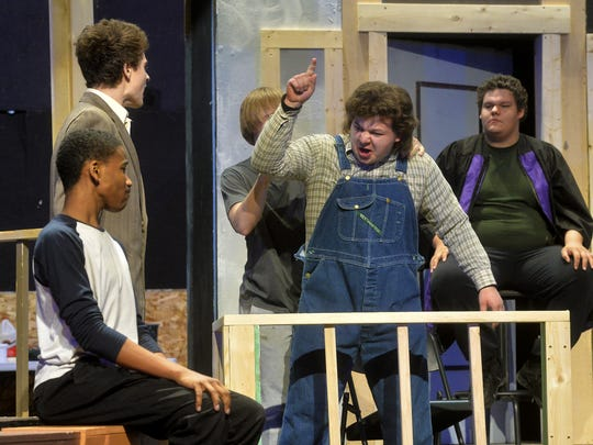 """Christensen Biller in the role of Bob Ewell rehearses part of the courtroom scene from the Great Falls High School production of """"To Kill a Mockingbird."""""""