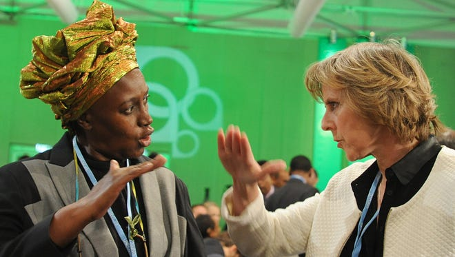 EU Commisioner for Climate Action Connie Hedegaard, right,  talks with Alice Akinyi Kaudia from Kenya prior to the opening of the High-level Segment of the UN Climate Change Conference in Warsaw, Poland on Tuesday.