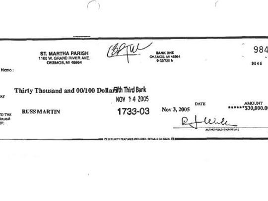 A copy of a check from St. Martha Parish to Russ Martin,