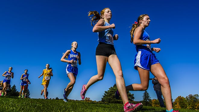 Grace Frost, second from right, is among the returners for a Lansing Catholic squad that has high expectations.
