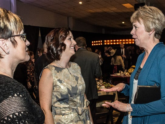Kim Thurlow, right, and Val Ray, left, both from Ivy Tech Community College, speak with Melissa Vance, middle, during the Wayne County Area Chamber of Commerce's annual awards dinner at the Wayne County Fairgrounds' Kuhlman Center on Jan. 19, 2018. (Editor's note: An earlier version of this article misidentified Thurlow. We regret the error.)