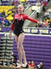 Deuel's Morgan Kwasniewski competes on beam. Kwasniewski,