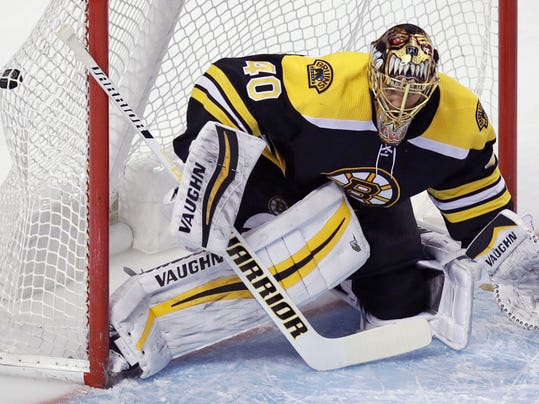 Boston Bruins goaltender Tuukka Rask (40) gets beat for a goal by Columbus Blue Jackets center Boone Jenner during the first period of an NHL hockey game in Boston, Monday, March 19, 2018. (AP Photo/Charles Krupa)