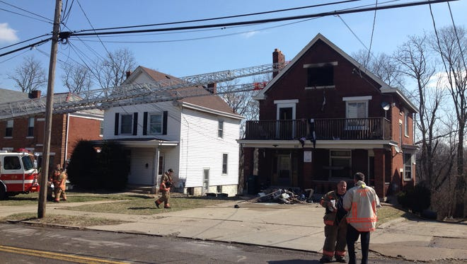 Firefighters at the scene of a West Price Hill fire that displaced five people Wednesday.