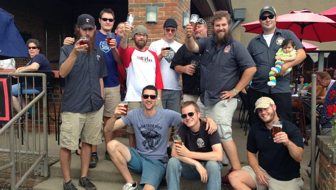 """Brewers are pictured at last year's """"Battle of the Local Beers"""" at Firehouse Grill."""