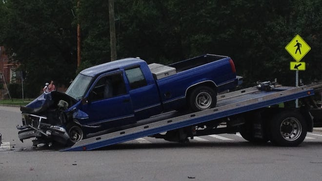 Five people were injured after a car ran a stop sign and hit this truck.
