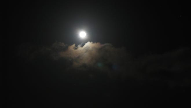 """The """"Honey"""" or """"Strawberry"""" full moon will be on display Friday the 13th."""