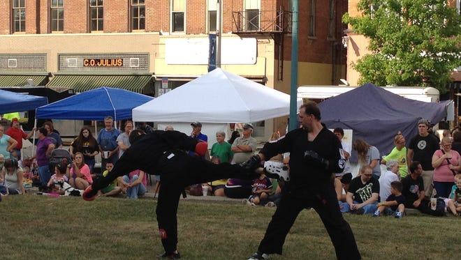 Members of Snow's Mixed Martial Arts put on a show Wednesday night on the Carroll County Courthouse lawn.