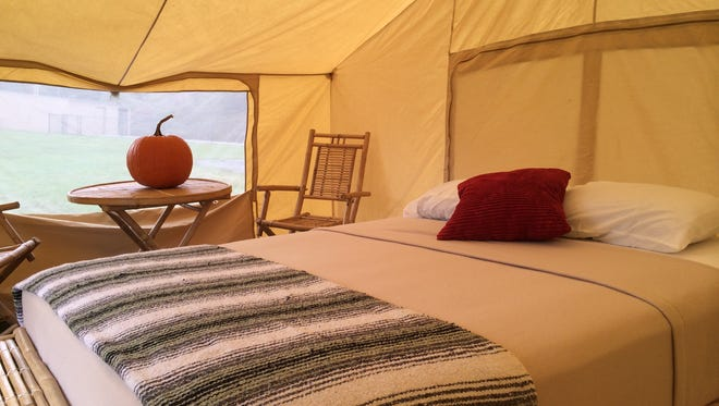 Indy 500 fans can spend four nights in this queen bed tent on the infield of the Indiana Motor Speedway for $1,100.