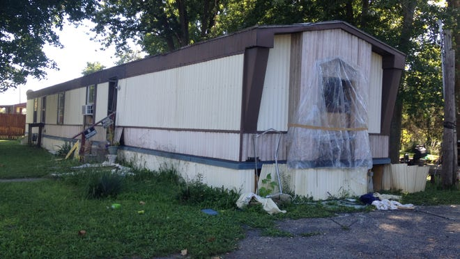 An Evansville woman who went missing in July was caged and held against her will inside this mobile home in Stewartsville, according to charging documents filed Sept. 8, 2014, in Posey Circuit Court in Mount Vernon. The photo shows the front of the trailer.