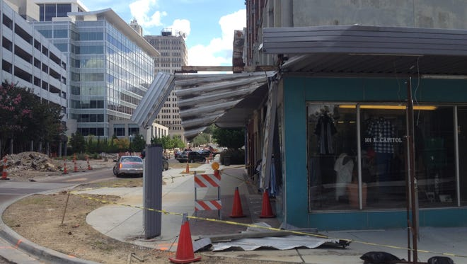 The damaged awning of Sam Dabit's clothing store in downtown Jackson