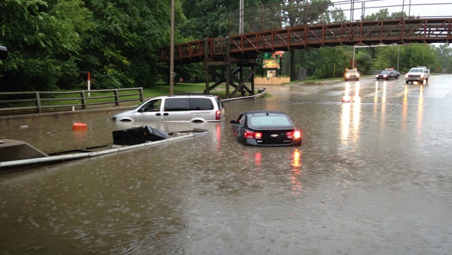 Flooding on Pennsylvania Avenue in Lansing on Tuesday.