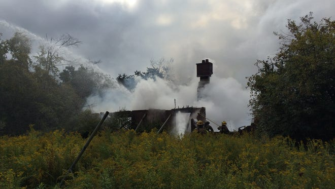 Firefighters from several departments are on the scene of a fire on State Road in East Lansing. The road is closed between Coolidge and Chandler roads.