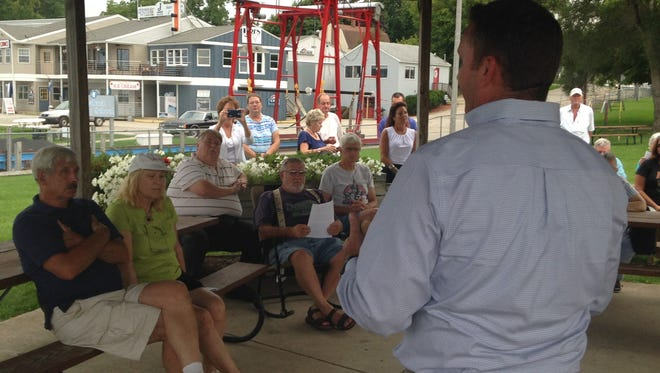 State Sen. Phil Pavlov, R-St. Clair Township talks to people Tuesday in Port Sanilac about a proposed nuclear waste site in Canada.