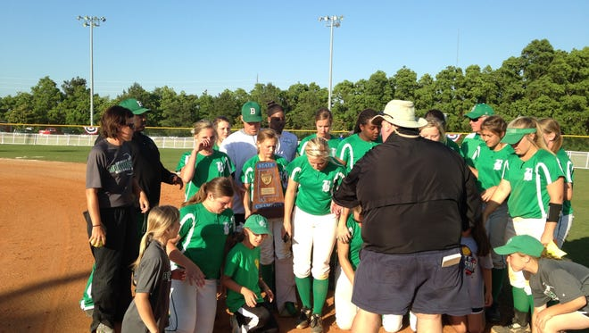 Brantley seventh grader Hannah Sims (center), who was injured in postgame celebration, holds the championship trophy.