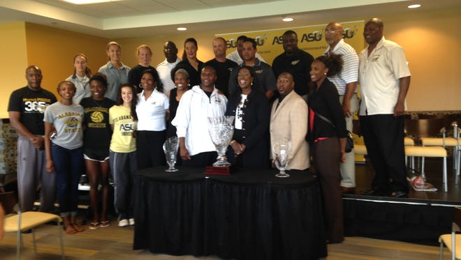ASU president Gwendolyn Boyd, flanked by interim athletic director Melvin Hines and football coach Reggie Barlow, poses with SWAC Commissioner's Cup on Thursday.