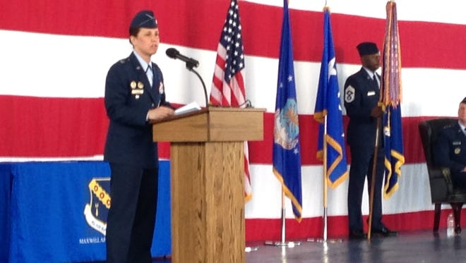 Col. Andrea Tullos speaks at an official change of command ceremony as she is given command of the 42nd Air Base Wing at Maxwell Friday.