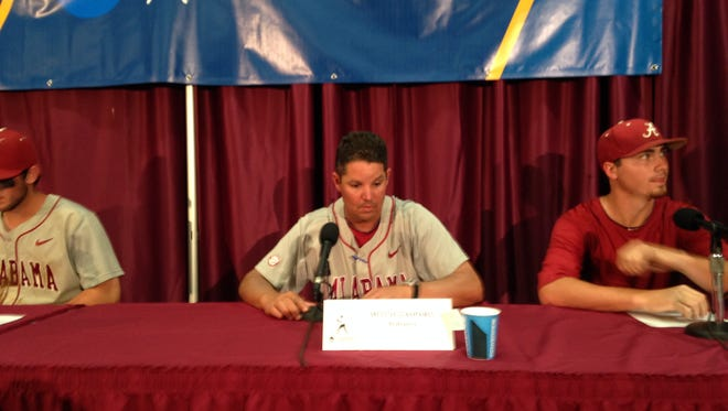 Alabama coach Mitch Gaspard, center, addresses the media after beating Florida State and is flanked by Mikey White, left, and Justin Kamplain, right.