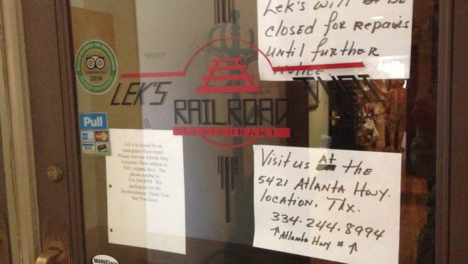 Signs on the door to Lek's Railroad Thai on Wednesday  state that the restaurant is closed for emergency floor repairs.