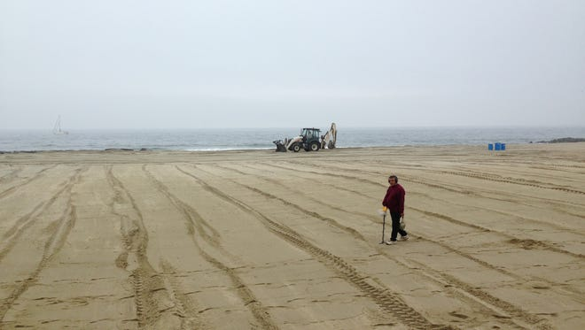 The Asbury Park beach is prepped in the rain Thursday for the Memorial Day crowd.