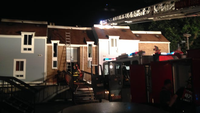 Firefighters battle a blaze at 107 Riverview Ave. in Neptune City.