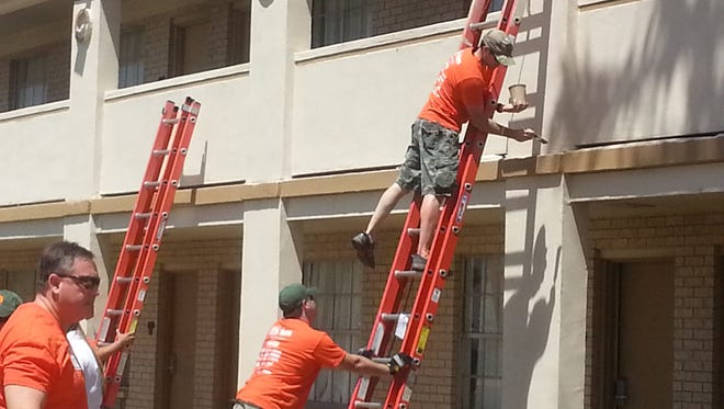 More than 250 volunteers from The Home Depot and its vendors helped renovate a veterans housing unit Wednesday.